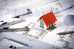 house-among-blueprints